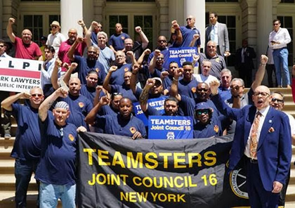Photo of Group holding Teamsters Joint Council 16 New York banner.